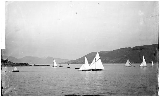Regatta, the harbour, Hong Kong. Photograph by John Thomson, 1871. Yachts in harbour. It is thought rowing was the first organized water sport in Hong Kong. In October 1849 the first recorded yacht race took place in the then British Crown Colony under the auspices of the Victoria Regatta Club, and over the next 40 years the Club continued to hold races sporadically. In the meantime, a group of oarsmen also got together to form another club in North Point, known as the Hong Kong Boat Club. After the formation of Hong Kong Corinthian Sailing Club in 1890, which later became the Royal Hong Kong Yacht Club, the regatta became a regular and celebrated event in Hong Kong. Here we see Victoria Harbour, then one of the finest harbours in the world. Contributors: J Thomson. Work ID: un374zcp.