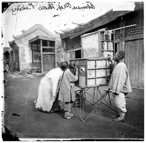 Chinese peep-show, Peking. Peking, Pechili province, China. Photograph, 1981, from a negative by John Thomson, 1869. Contributors: J Thomson. Work ID: kafxtwxs.