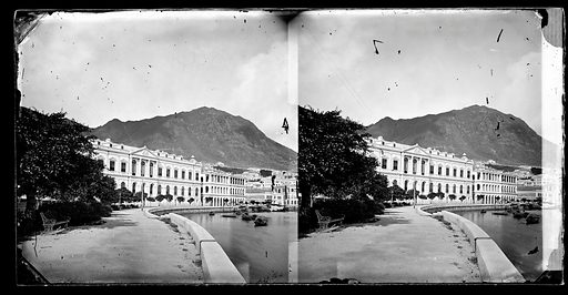 Waterfront, Hong Kong. Photograph by John Thomson, 1868/1871. View looking towards west. The building on the left, with the Royal Crest, is the City Hall. Contributors: J Thomson. Work ID: fpctwejg.