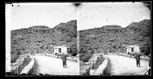 Road with three figures, Hong Kong. Photograph by John Thomson, 1868/1871. Contributors: J Thomson. Work ID: jpauwqp4.