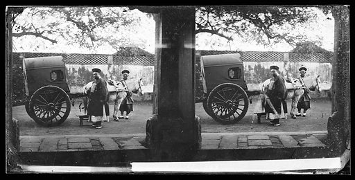China. Photograph by John Thomson, 1869. A man standing beside a two-wheeled cart with a canvas cab. A horse or donkey in harness, another man standing behind the head of the horse. A wall behind them with a pierced pattern at the top. Created 1869. Contributors: J Thomson (1837–1921). Work ID: rz6868qh.