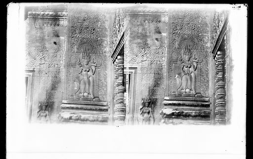 Nakhon Thom [Angkor Wat], Cambodia. Photograph by John Thomson, 1866. A section of wall with a relief carving of a female figure [apsara?]. Created 1866. Angkor Wat (Angkor). Contributors: J Thomson (1837–1921). Work ID: rn4q73ee.