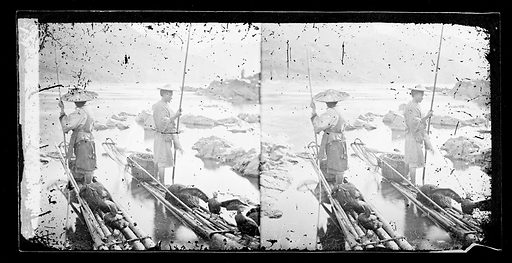 Two people fishing with cormorants from canoes. River Min, Fukien province, China. Photograph by John Thomson, 1870/1871. Contributors: J Thomson. Work ID: zfhr62wz.