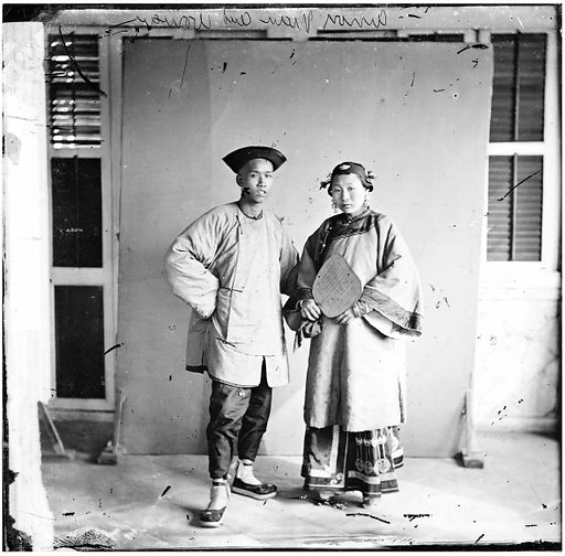 Amoy man and woman by John Thomson. Amoy, Fukien province, China: a married couple, standing. Photograph by John Thomson, 1870. Contributors: J Thomson. Work ID: qm39cynw.