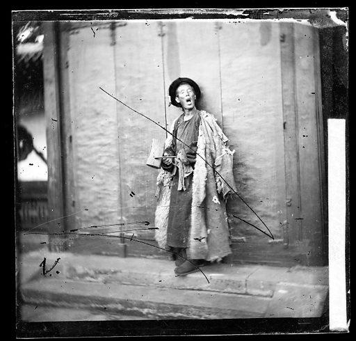 A nightwatchman, Peking, by John Thomson, 1869. Peking, Pechili Province, China: a nightwatchman. Photograph by John Thomson, 1869. Contributors: J Thomson. Work ID: wz74qwqw.