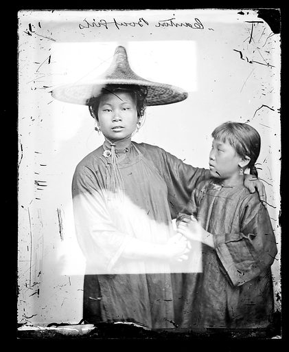 Canton boat girls by John Thomson. Canton, Kwangtung province, China. Photograph by John Thomson, 1869. Contributors: J Thomson. Work ID: ywhjgvyk.
