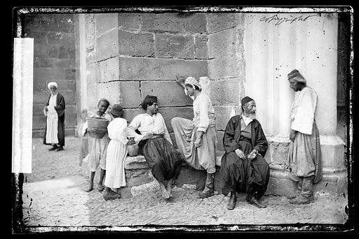 A posed group of seven natives, Nicosia, Cyprus. Nicosia, Cyprus. Photograph by John Thomson, 1878. Contributors: J Thomson. Work ID: pfn4tjek.
