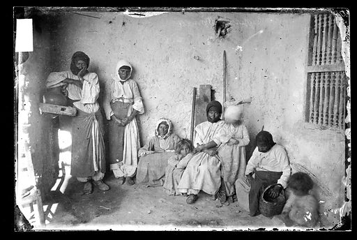 Cyprian women and children in a bare room. Cyprus. Photograph by John Thomson, 1878. Contributors: J Thomson. Work ID: gtpuc44p.