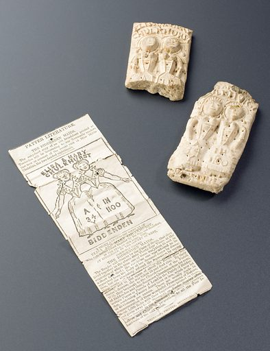 """Biddenden Maids cake and newspaper cutting, England. Elisa and Mary Chulkhurst (1100–1134) were conjoined twins named after their home town of Biddenden, in Kent, England. They lived for 34 years joined at the hips and shoulders, until one of the twins died. The other refused to be separated from her dead twin saying """"As we came together we will go together"""" and died six hours later. The twins are said to have left land to the Church, the rental income from which was to be used to purchase food for the poor to be distributed on Easter Sunday. Cakes bearing the image of the twins were also to be distributed. Today, cakes are distributed to the elderly on Easter Monday. Contributors: Science Museum, London. Work ID: pebjk539."""