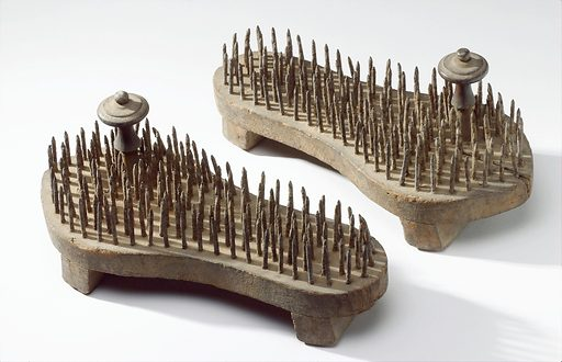 Pair of fakir's sandals, Indian 1871–1920. Pair of fakir's sandals, with iron spikes through soles and wooden toe pegs, Indian, 1871–1920. Contributors: Science Museum, London. Work ID: kadxxa6a.