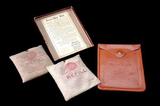 Bed warming bag, London, England, 1900–1925. The makers of this novel device claimed it could provide constant heat and warmth for 24 hours. The canvas bags are filled with an ammonia compound which, when cold water is added, produce heat. The brass clips on the top of the bag were opened and two teaspoons of cold water were added through a funnel. The clips were then closed and the bag shaken for one minute. The canvas bag was then placed in the rubber bag. The ammonia compound probably smelt horrible. The bag was used to provide heat to a specific area of the body to relieve pain or to warm up beds. The devils on the packaging hint to the customer that the bag will stay hot and are probably an allusion to Hell!. Contributors: Science Museum, London. Work ID: uzaem75w.