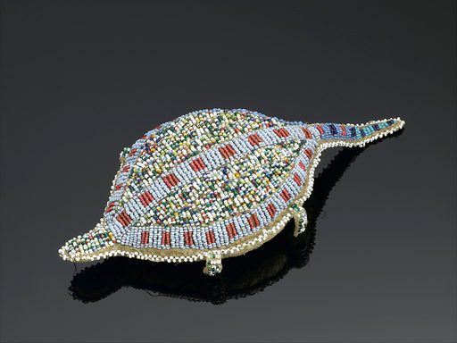 Turtle shaped amulet, North America, 1880–1920. Decorated with beading, this turtle-shaped amulet made from animal hide is thought to contain an umbilical cord. The amulet was worn by girls until they reached puberty to ward of illness. In many Native American belief systems, turtles were thought to look after women's diseases. Protection. Contributors: Science Museum, London. Work ID: jwe5sfaj.