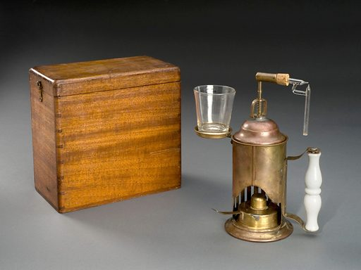 Metal antiseptic spray, with pottery handle and glass nozzle, in wooden box. Full view, graduated black background, with box. Contributors: Science Museum, London. Work ID: bsmkez86.
