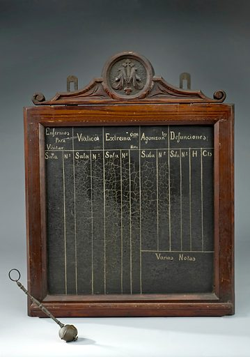 Blackboard from the ward of a Spanish monastic infirmary, 17. This blackboard was used to record information about patients, or enfermos in Spanish. It records notes about the patient, his or her condition, and whether they were improving, were dying or had died. It may also be a record of visitors to patients. The attached sprinkler was probably to allow regular blessings of the infirmary with holy water. Religious orders were one of the few providers to care for the sick, especially before the rise of the hospital as we know it. Contributors: Science Museum, London. Work ID: yp876qva.