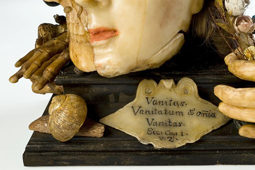 Wax model of a female head depicting life and death, European, possibly 18th century. With plaque giving quote from Bible; Ecclesiastes, Chapter 1, verse 2; Vanitas vanitates et omnia vanitas. Contributors: Science Museum, London. Work ID: bvyd9wga.