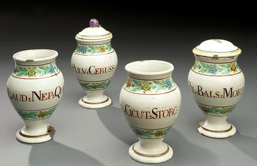 """Dispensing pot for laudanum, Italy, 1771–1830. Some of the ingredients used in medical treatments seem to belong to the world of fantasy rather than pharmacy. On the far left is a dispensing pot labelled """"LAUD:NEP:QUERC"""". This is laudanum, a treatment made from opium, gold and pearls. Mixed with a powdered bezoar stone from the stomach of an animal and shavings of mythical unicorn horn, the medicine was given to aid sleep and ease pain. The jar, one of four shown here, was presented as a gift to the Wellcome collection on the previous owner's death in 1932. Controlled drug. Contributors: Science Museum, London. Work ID: nnqbxwfk."""