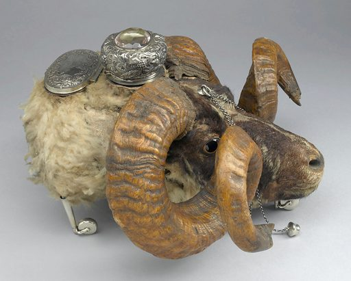 Snuffbox in the form of a ram's head, Edinburgh, Scotland, 1881–1882. Snuff is powdered tobacco that is inhaled through the nose. The practice of 'taking snuff' became common in Europe in the 1600s and was hugely popular throughout the 1700s. This ram's head on wheels is known as a 'snuff mull' and essentially acts as an oversized snuff box. The ram was almost certainly a former regimental mascot whose faithful service would have been commemorated by preserving its head in this fashion. As such it would have been brought out for use at regimental dinners and other gatherings. It has two silver-lidded compartments for holding snuff and would have been placed on a table and passed around for everyone to use. Snuff was well liked for its aroma, taste and nicotine boost. It was also believed to ward off colds and to be good for the relief of ear, nose and throat problems. Snuff boxes were a practical necessity, but could also be symbols of social standing and came in many different materials and shapes. Contributors: Science Museum, London. Work ID: rqugyrq9.