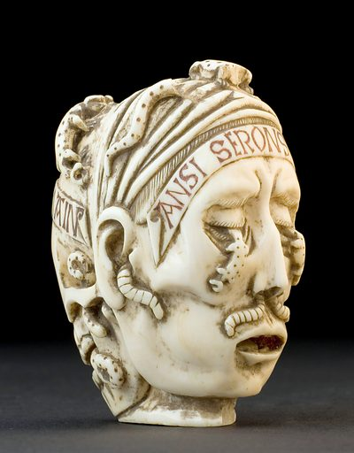 Ivory model of a skull and a human head, France, undated. One side of this carved ivory head shows a human face crawling with worms; the other side shows a skull crawling with toads after the worms have eaten away at the flesh. Not much is known about this model, but it is thought that it is a memento mori – literally a reminder of death and the shortness of life. The skull was the symbol of death from the 1500s onwards. Previously death was represented as a skeleton accompanied by a living victim. The model was purchased from a private collection in Rome, Italy, in 1932. Contributors: Science Museum, London. Work ID: u38jguad.