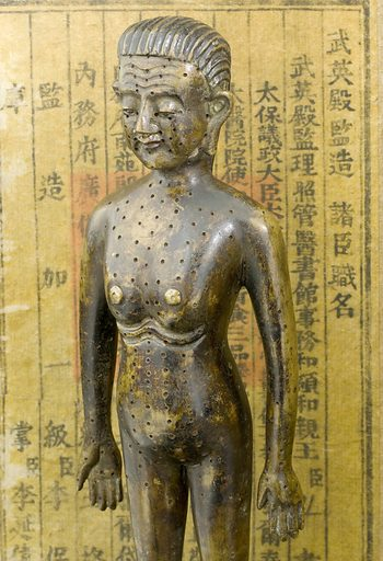 Bronze acupuncture figure, in silk covered box bearing text of an Imperial decree of Yung Chen, chinese, early 18th century Detail shot of top half of object. Contributors: Science Museum, London. Work ID: w9mfnwy9.