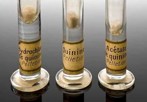 From left too right: A182555, Original preparation of quinine hydrochloride by Pelletier, 1810–1840. A182561, Original preparation of quinine by Pelletier and Caveton, 1820. A182556, Original preparation of quinine acetate by Pelletier, 1810–1840. Detail image of labels, graduated black perspex background. Contributors: Science Museum, London. Work ID: f3h8639h.