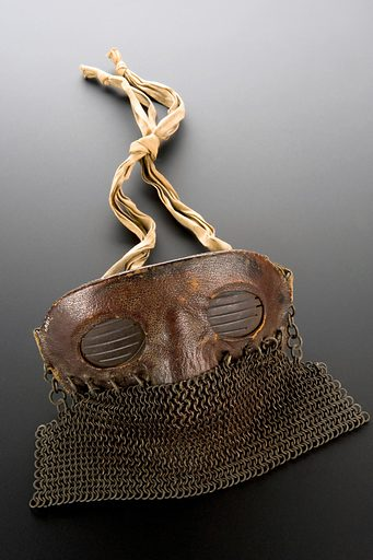 Protective mask, leather and chain mail, worn by tank crews, probably British, 1917–1918. Full view, graduated matt black perspex background. Contributors: Science Museum, London. Work ID: tzav3tmn.