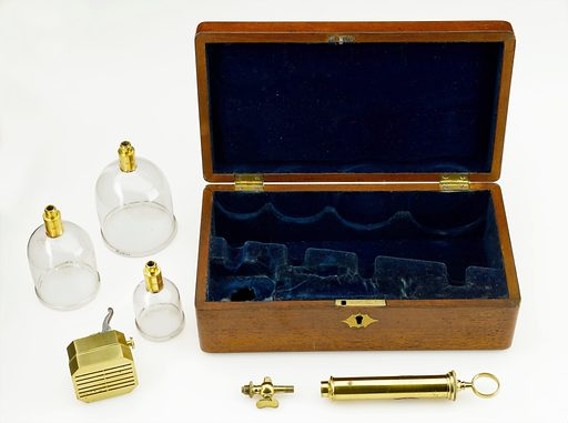 Cupping set, London, England, 1831–1870. A number of instruments could be used for bloodletting, some of which are shown here. The scarificator, which was first developed in the 1600s, has twelve blades that cut into the skin when a trigger is released. The cupping glasses, of which three out of four are shown here, were used to draw blood from the skin. This was done after use of the scarificator and was known as wet cupping. In dry cupping, the vacuum produced as heated cups cool draws liquid from the tissues. The syringe could be attached to the individual cups to further encourage the flow of blood. A stopcock can also be seen. It fits between the syringe and the cupping glass to regulate blood flow. The set was manufactured by surgical instrument makers Walter and Co Contributors: Science Museum, London. Work ID: uszamuzj.