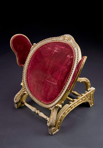 Adjustable bed rest, England, 1720–1800. Made from plaster and wood with padded red velvet supports this bed rest could be used in a hospital or at home to support a person who had been confined to bed – perhaps for medical reasons. It has six different positions and is adjusted using a ratchet, the set of teeth on the edge of the support bars ensures the rest stays in position. The arm supports are also adjustable. Judging from the quality of the materials and design, the rest was used by a wealthy person. Contributors: Science Museum, London. Work ID: ym5ndvq5.
