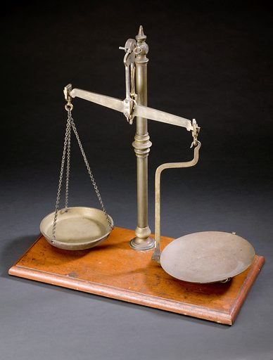Apothecary's balance, Europe, 1901–1930. A balance is used to measure out ingredients for medical treatments. Accurately measuring out ingredients is vital to ensure the patient takes the correct dosage. Placing weights of known heaviness on one brass pan allowed ingredients to be measured accurately in the other. When the pans are balanced the lead indicator hangs straight. Contributors: Science Museum, London. Work ID: bcyu7ttj.