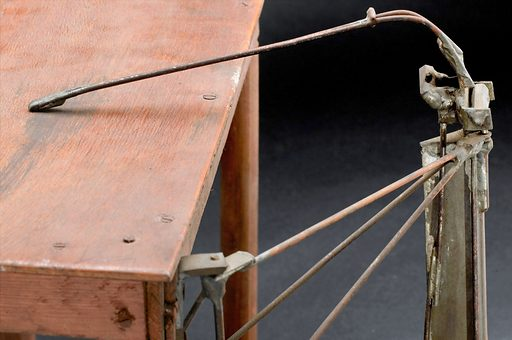 Prototype model of mechanical arm, made by George Thomson, Edinburgh, 1919. Detail view. Graduated grey background. Contributors: Science Museum, London. Work ID: emxgkzt4.