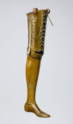 Artificial left leg, London, England, 1861–1920. Someone who had their left leg amputated on the knee joint used this artificial leg. The leather corset secures the prosthesis to the thigh. It is perforated so the wearer will not get too hot. Inside the calf is a v-shaped metal bar attached to a spring. This prevents the wearer falling forward yet allows them to walk with comfort. The ankle and knee joints are lockable. The toes are made of flexible leather. William Robert Grossmith's company made this limb. He also wrote 'Amputations and Prosthetic Limbs' in 1857. Contributors: Science Museum, London. Work ID: jkuwfch4.