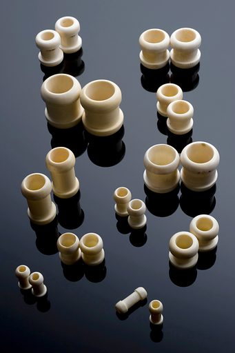Gastro-intestinal bobbins, United Kingdom, 1880–1920. These bobbins would have been used to create a surgical anastomosis, a process by which two sections of hollow organs can be connected together. They were used most commonly during operations on the intestines. The bobbin would be secured by sutures and the gut allowed to heal without narrowing. These bobbins are made from bone with the calcium removed. When the gut had healed the bone was digested. Gastro-intestinal surgery. Surgical bobbin. Contributors: Science Museum, London. Work ID: adh3krka.