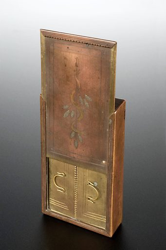 Copy of Roman pocket medicine chest. The brass medicine chest has four separate compartments which would each have contained a different medical treatment. On the lid, a rod of Asklepios has been engraved. A caduceus is a snake entwined around a rod or staff. This is a symbol of medicine and is associated with the Greek and Roman healing god, Asklepios. Contributors: Science Museum, London. Work ID: hxhta5na.