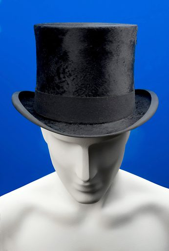 """Top hat, London, England, 1831–1920. During the 1800s the physician's job became more defined and their social standing improved – signified by this high quality top hat. It is covered with cloth, has a leather interior and was made by a milliner (hat maker) called Cuthbertson. Physicians became a unified professional class to rival the clergy and lawyers. The British Medical Association was founded in 1832 to """"promote the medical and allied sciences and to maintain the honour and interests of the medical profession"""". Physicians were in a competitive market with a whole range of other practitioners, including chemists, homeopaths and herbalists. Contributors: Science Museum, London. Work ID: xbahya66."""