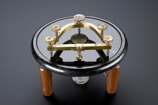 Freezing microtome, London, England, 1883–1885. Invented in 1881, this type of freezing microtome used ice and salt to freeze animal and plant specimens to be sliced for microscope slides. Ice and salt were replaced by a removable ether spray in 1883. Freezing hardened and preserved the specimens' structure quickly. Chemical preservation usually took six weeks but by using ether the process took a matter of seconds. Once frozen, a razor, operated by hand and secured by a tripod, moved across the top of specimen, creating slices. The slices were then mounted, stained and studied under the microscope by histologists. The knife and tubing is missing. Valentin knife. Contributors: Science Museum, London. Work ID: zhbezbuf.