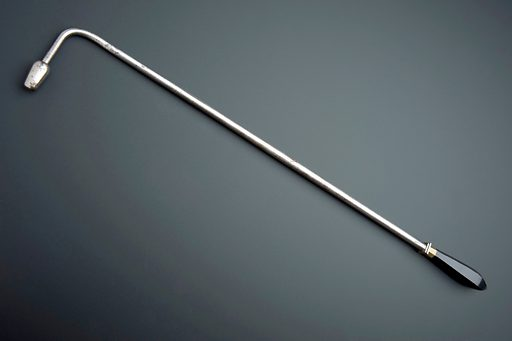 Long handled cautery, Europe, undated. Bubonic plague causes enlarged glands or buboes on the neck, groin and armpits. The buboes were cauterised in an attempt to prevent larger buboes forming but it probably did not save many lives. (Cauterisation is the use of heat to burn or remove part of the body.) It was thought that the disease spread from human contact, which is why this cautery has a long handle. Bubonic plague is actually transmitted by fleas on rats. Contributors: Science Museum, London. Work ID: pc5ubnbk.