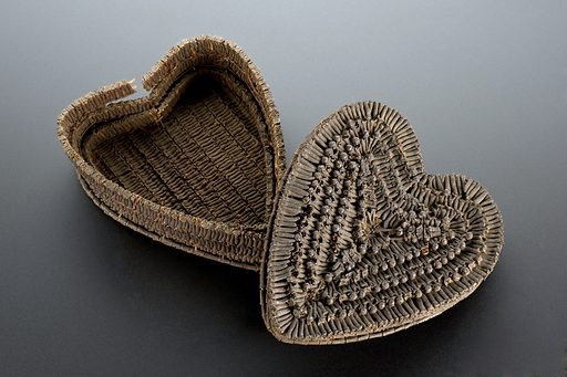 Heart shaped basket made entirely from cloves. This basket is made from cloves. They are the strong smelling and aromatic dried flower buds of the tree Caryophyllus aromaticus. This basket was made to ward off disease, especially during epidemics. It was thought by some that disease was spread by foul smells and that the strong odour of cloves repelled the vapours. Today, clove oil is used as a home remedy for toothache as it has pain relieving qualities. Contributors: Science Museum, London. Work ID: szgyr4su.