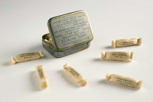 A675774, Small tin, contains amyl nitrite ampoules made by Burroughs Wellcome and Co of London, English 1910. White background, some capsules spilled in front of case. Contributors: Science Museum, London. Work ID: v9h74ykd.