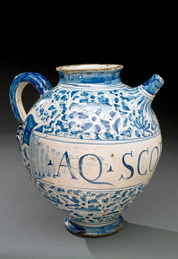 """Syrup jar used to store Viper's Grass Water, Rome, Italy, 17. The words Aqua Scorzonarie painted on the front of this jar translate from Latin as """"Viper's Grass Water"""". Scorzonera is a plant of the daisy family with purple-brown edible roots and is commonly called 'viper's grass'. It would have formed the basis for this treatment when infused in water. Contributors: Science Museum, London. Work ID: bsk6t7v9."""