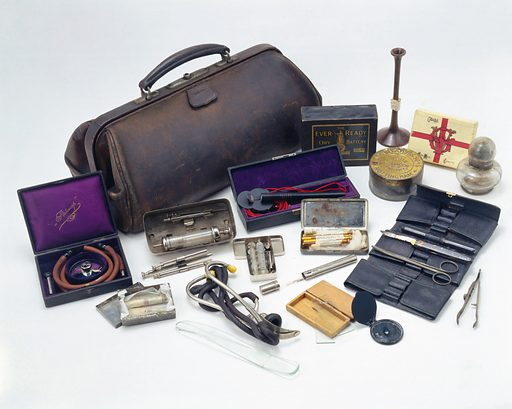 Leather doctor's bag with contents, English, 1890–1930. The bag and its contents originally belonged to Professor John Hill Abram, and consist of a variety of medical instruments including stethoscopes and syringes. Front three quarter view. White background. Contributors: Science Museum, London. Work ID: nsufg3gv.
