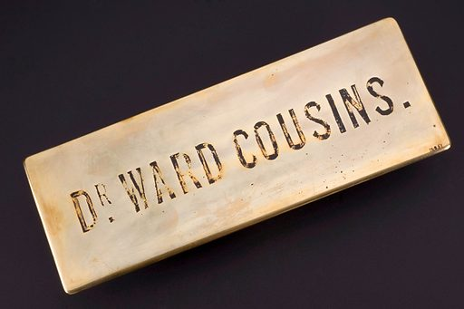 """Door plate, England, 1860–1910. Dr John Ward Cousins (1834–1921), who owned this brass door plate, was a surgeon and ophthalmologist – eye specialist – working in Portsmouth, England from 1860 to 1920. Throughout the 1800s the physician's job became more defined and their social standing improved. They became a unified professional class to rival the clergy and lawyers. The British Medical Association was founded in 1832 to """"promote the medical and allied sciences and to maintain the honour and interests of the medical profession"""". Contributors: Science Museum, London. Work ID: cmvevynx."""