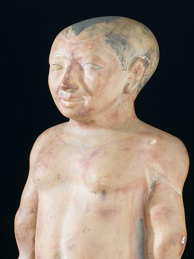 Plaster statue of the dwarf chnoum-hotep, a victim of achondroplasia, 2000 – 1000 BC. Front three quarter detail view. Black background. Contributors: Science Museum, London. Work ID: dj957nv9.