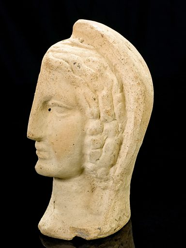 Left half of a a terracotta female head, Roman, 200 BCE-200. Votive offerings were made at the temple of a healing god such as Asklepios, the Greco-Roman god of healing and medicine, in the hope of receiving a cure or as thanks for one. Made from terracotta, this shows the left side of a woman's head. She may have been experiencing chronic headaches. Contributors: Science Museum, London. Work ID: s4tsjnk2.