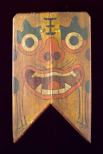 Wooden sign painted with a demon's face, China, 1801–1900. This image of a demon's face was intended to be hung on the doors of homes in China to ward off evil spirits. One of the more ancient aspects of Traditional Chinese Medicine (TCM) was the belief that spirits, ancestors and demons interfere with the body and cause illness. Shield. Contributors: Science Museum, London. Work ID: drjuvcjy.