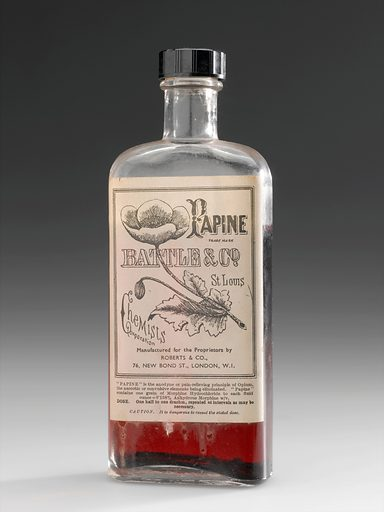 Bottle of 'Papine', London, England, 1890–1920. 'Papine' is a trade name for an effective pain killer. It is known as an opiate, which means it is a naturally occurring compound in the opium poppy. The Latin name of this poppy is Papaver somniferum, and suggests where the brand name came from. The label on the bottle promises that the sleep and seizure-inducing effects of opium have been removed. Opium and opiates are known to be addictive and if taken for long enough may lead to dependence on the drug. 'Papine' was available over the counter at chemists. Contributors: Science Museum, London. Work ID: ynutcb9u.
