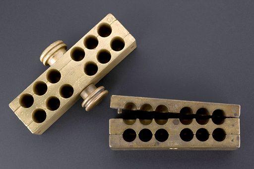 Brass pessary mould, London, England, 1901–1918. A pessary can be one of three things: a device to support the vagina or rectum; a form of contraception; or a medical treatment. This mould was used to make twelve medicated pessaries. The heated mixture was poured into moulds and cooled. The mould would be opened and the pessaries popped out, packaged and sold. Suppository. Contributors: Science Museum, London. Work ID: j3x4khe9.