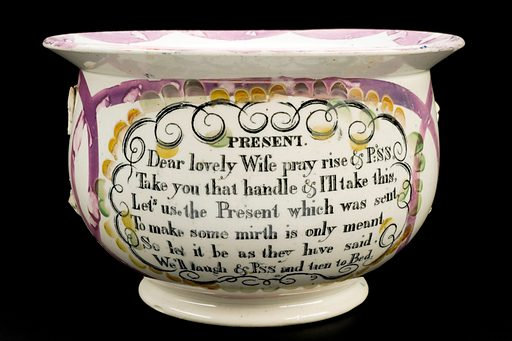 Earthenware chamber pot, glazed and inscribed with poems. Full view, Present poem side. Black background. Contributors: Science Museum, London. Work ID: pr35qp5u.