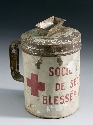 Collecting box, metal, for wounded soldiers. French, 1914 – 1918. Front three quarter view. Graduated grey background. Contributors: Science Museum, London. Work ID: y4tyaget.