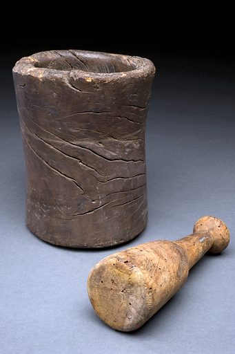 Wooden mortar and pestle, Europe, 1501–1800. Mortars and pestles were a key part of every pharmacist's and apothecary's equipment. The pestle, carved from a single piece of wood, is used to pound and mash medicinal plants and herbs and grind up hard ingredients used in medical treatments. The mortar, which in this example looks as though it has been made from a tree branch, is a bowl used to pound against. Today, mortars and pestles are more likely to be found in kitchens rather than pharmacies. Contributors: Science Museum, London. Work ID: ppyuk7e4.