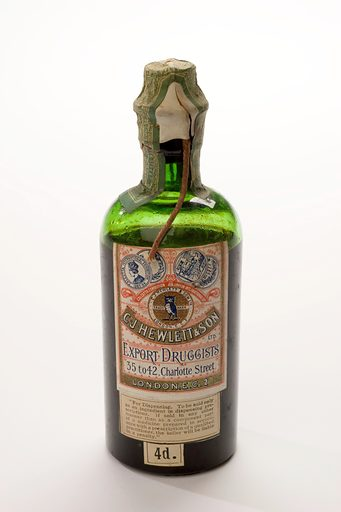 Sealed bottle of Hewlett's Damian compound mixture prepared by CJHewlett and Son London. View of front of bottle, white background. Contributors: Science Museum, London. Work ID: sec7ay2g.