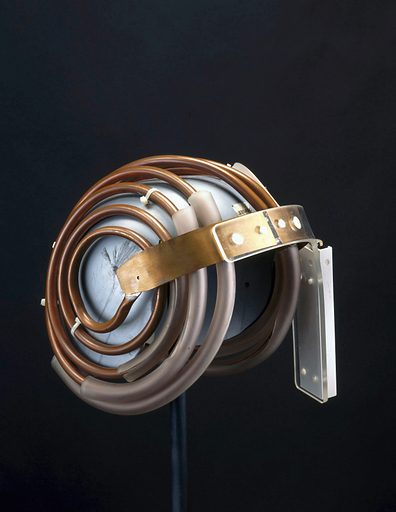 'Jedi' helmet, used with Cryogenic Magnetic Resonance Imaging Machine. To take MRI (Magnetic Resonance Imaging) scans of the brain, these helmets were worn by children and adults. The coils are aerials for picking up MRI signals. Naming them after the Jedi knights in Star Wars films encouraged children to put them on and not to be frightened. MRI builds up a picture of the human body by using high frequency radio waves known as NMR (Nuclear Magnetic Resonance). MRI does not expose the body to radiation or invasive surgery and it can image soft tissues more effectively than X-ray-based methods. Contributors: Science Museum, London. Work ID: sgtx5waw.